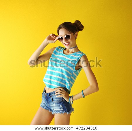 Beautiful girl on yellow background