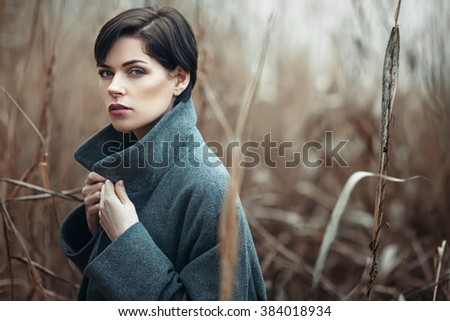 Beautiful girl outdoors in autumn - stock photo