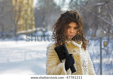 Beautiful girl outside in St-Petersburg in winter - stock photo
