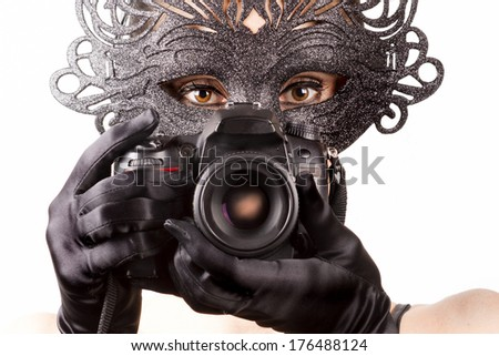 beautiful girl photographer masquerade  - stock photo