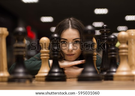 beautiful girl playing chess