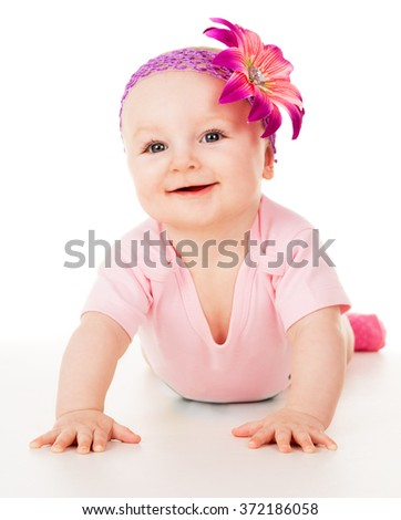 Beautiful girl playing on the floor on a white background