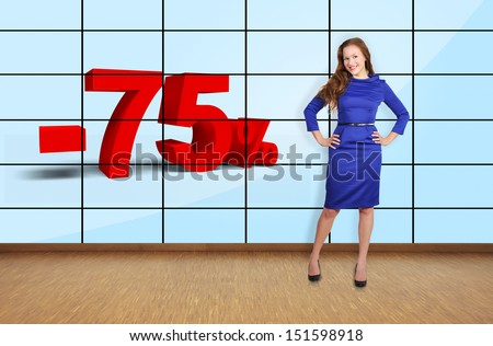 beautiful girl pointing at discount on plasma wall - stock photo