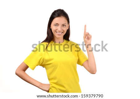 Beautiful girl pointing up. Attractive girl with yellow t-shirt. Isolated on white. - stock photo