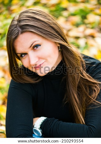 beautiful girl portrait in a park  - stock photo