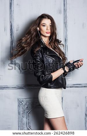 Beautiful girl portrait in rock style - stock photo