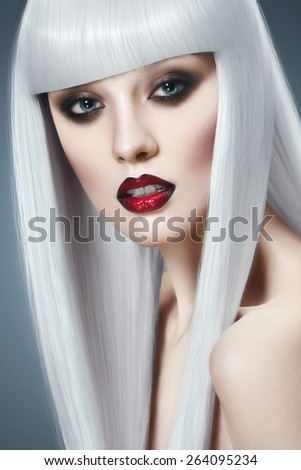 Beautiful girl portrait in white wig - stock photo