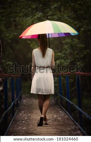 beautiful girl portrait with colorful umbrella - stock photo