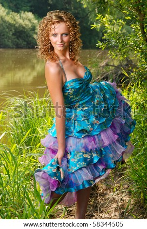 Beautiful girl posing at the river