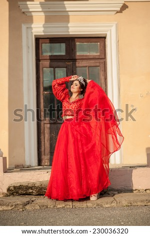 Beautiful girl posing near the old palace, dynamics, top-down