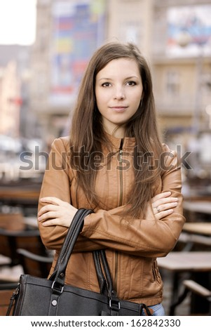 Beautiful girl posing on the street. - stock photo