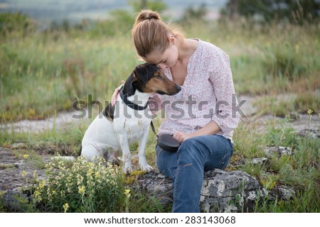 Beautiful girl posing with a dog. Outdoor portrait - stock photo