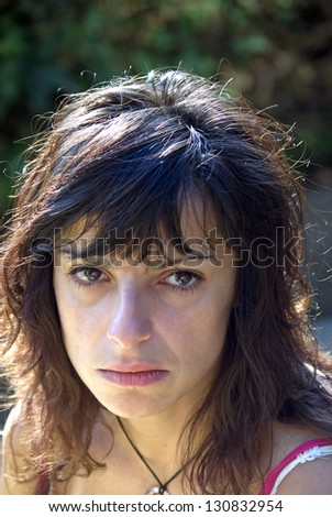 beautiful girl pouting with sad eyes - stock photo