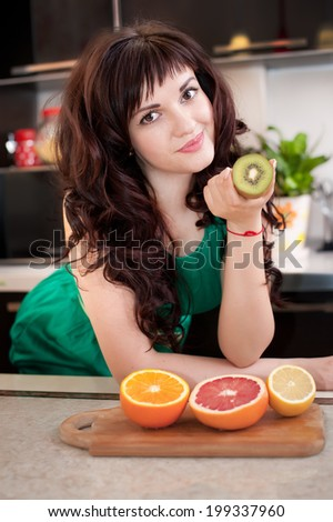beautiful girl preparing food on  kitchen