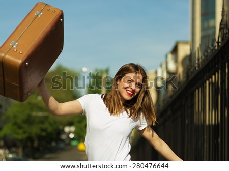 Beautiful girl ready for journey. Retro look image - stock photo