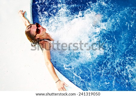 Beautiful girl relaxing in jacuzzi. Summer vacation - stock photo
