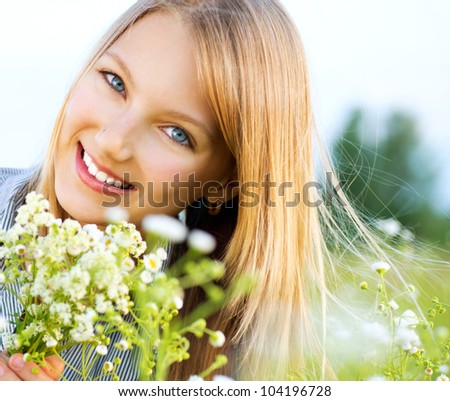 Beautiful Girl Relaxing outdoors. Happy and Smiling - stock photo