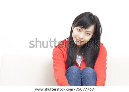 beautiful girl resting on sofa at home - stock photo