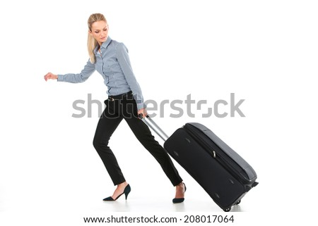 beautiful girl running with big luggage. side view of young girl on white background - stock photo