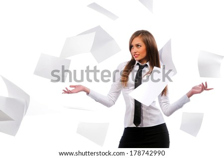 Beautiful girl scatters documents. White background, isolated. - stock photo