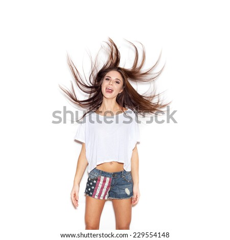 Beautiful girl shaking her hair . White background, not isolated - stock photo