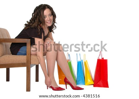 Beautiful girl shopping for shoes isolated on a white background - stock photo