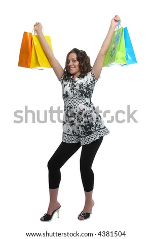Beautiful girl shopping showing excitement on white background - stock photo