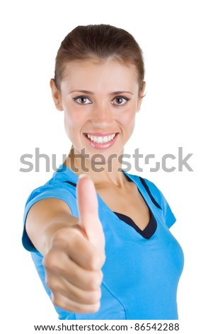 Beautiful girl showing a thumb up, isolated on white background