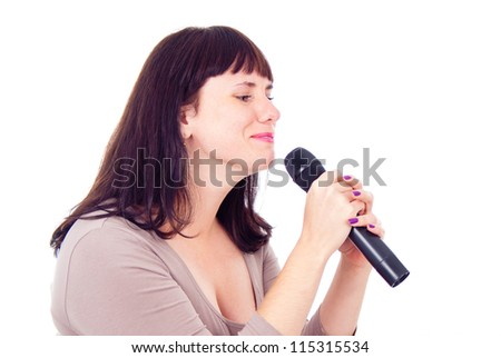 Beautiful girl singing into the microphone, isolated on white background