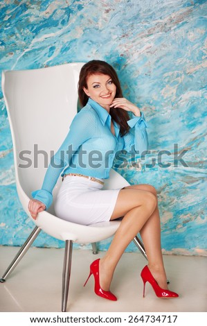 Beautiful girl sit in the white chair