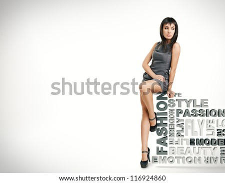 beautiful girl sits on words on a white background. fashion theme - stock photo