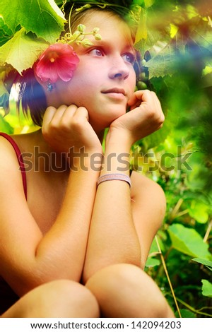 beautiful girl sitting in a pleasant garden.