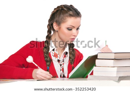 beautiful girl sitting in front of books, isolated background - stock photo