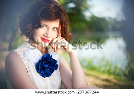 Beautiful girl sitting on grass on sunny day