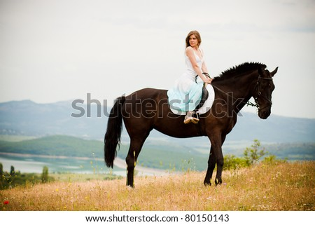 beautiful girl sitting on the horse