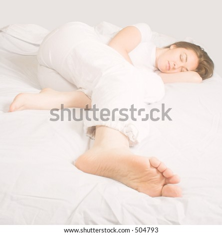 beautiful girl sleeping on a white bed