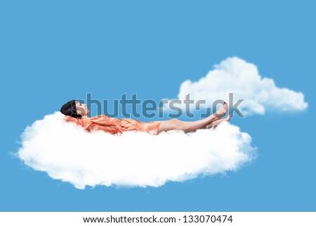 Beautiful girl, sleeping on a white cloud - stock photo