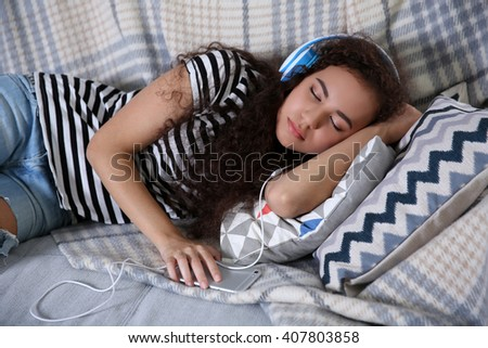 Beautiful girl sleeping on couch - stock photo