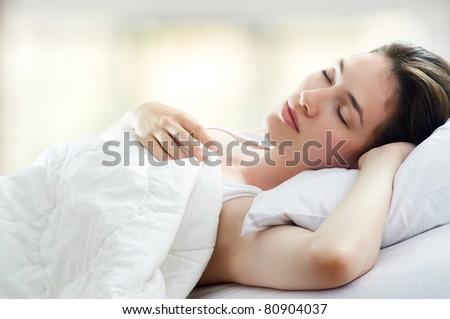 beautiful girl sleeps in the bedroom - stock photo