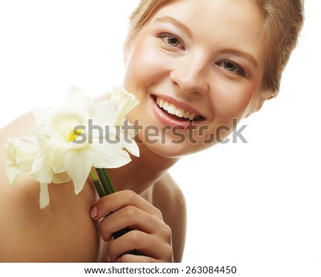 beautiful girl smiling and with flower narcissus, isolated on white - stock photo