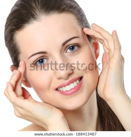 Beautiful girl smiling with fresh and clean face. Beauty and spa conceptual