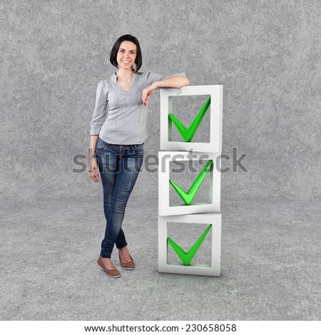 Beautiful girl stand with a check list - stock photo