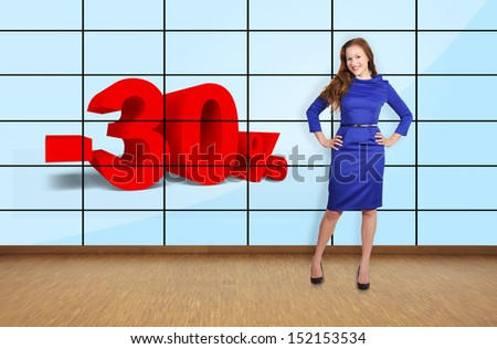 beautiful girl standing in office at discount on plasma wall - stock photo