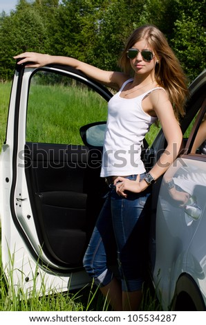 Beautiful girl stands near to white car