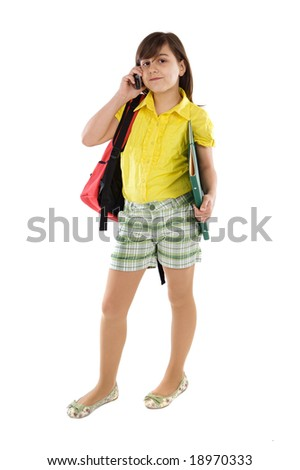 Beautiful girl student speaking by phone on a over white background - stock photo