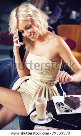 Beautiful girl talking by phone - stock photo