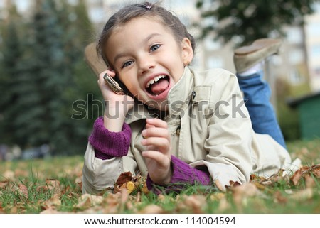 beautiful girl talking on cell phone - stock photo