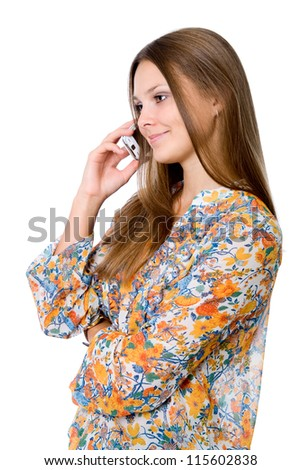 Beautiful girl talking on cell phone, isolated over white background - stock photo