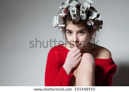 beautiful girl teenager with curlers on her head - stock photo