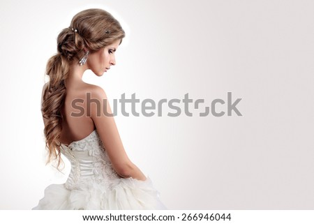 beautiful girl the bride on a background of bright stucco - stock photo
